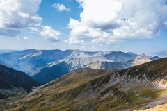 Mountain ridges in Fagaras Mountains on a lovely summer day. Never stop hiking stock photos