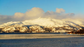 Mountain rising above the frozen lake Royalty Free Stock Image