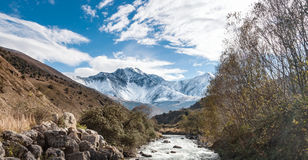 Mountain rive. Nature view of the Caucasus Ossetia, Fiagdon river gorge fall mountains sky stones, snow, clouds trees Royalty Free Stock Images