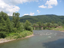Mountain river. The mountain river with the railway bridge, Carpathian Mountains, Ukraine royalty free stock photos