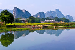 Mountain and river. A village between rock mountain and river-Yingde China royalty free stock images