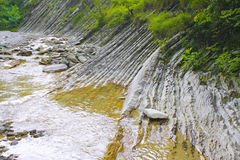Mountain river. Mountain river moves among the low mountains in the form of layers in Russia stock photography