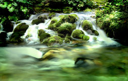 Mountain River. A mountain river with stream falling into it Stock Photography