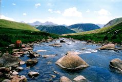 Mountain river. Fine blue mountain small river on a background of mountains and the sky Stock Photography