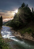 Mountain river. Picturesque scenery of mountain river and sunset stock image