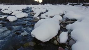 Mountain river aerial. Flying over a mountain river in winter time stock video