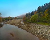 Mountain river in autumn. Rocky shore. Multi-colour wood Stock Photo