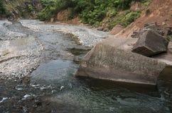 Mountain river with a big rock Stock Photos