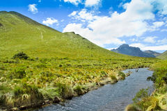 Mountain, river with blue sky and  clouds Royalty Free Stock Photos