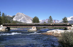 Mountain River with Bridge. Bridge across Tuolumne River in Yosemite National Park, California, USA stock images