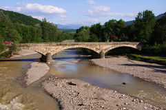 Mountain river and bridge Royalty Free Stock Photo