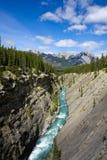 Mountain river canyon. Photo of a mountain river canyon with blue sky Stock Photos