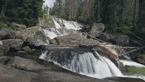 Mountain river with cascade waterfall in forest stock video footage