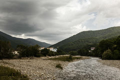 Mountain river on a cloudy day in Sochi. Mountain river on a cloudy day Royalty Free Stock Photography