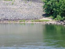 Mountain River. Fast flowing mountain river, surrounded by wooded banks and dotted with large rocks stock photography
