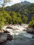 Mountain river. Fast mountain river mountains in the background Royalty Free Stock Photos