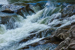 Mountain river fast water flow Royalty Free Stock Photography