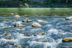 Mountain river flow stone landscape long exposure photo, blurred Royalty Free Stock Photo
