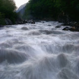 Mountain river flow Stock Photography