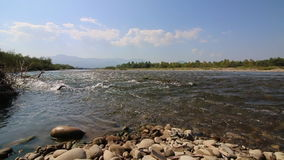 Mountain river flowing down into the valley. stock footage