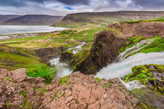 Mountain river flowing into the lake between the mountains, Iceland Stock Images