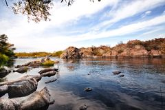 Mountain river flowing among the picturesque Royalty Free Stock Photos