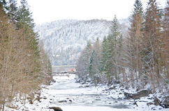 Mountain river flowing rapidly Lamai ice and honing stones rocks. Stock Photos
