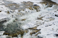 Mountain river flowing rapidly Lamai ice and honing stones rocks. Mountain river flowing rapidly Lamai ice and honing stones rocks royalty free stock photo