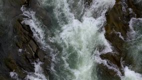 Mountain river flowing through stones stock video footage