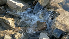 Mountain river flowing swiftly over rocks stock video footage
