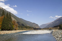 Mountain river flowing in the valley of the Caucasus Royalty Free Stock Photos