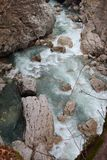The mountain river flows among the boulders in the gorge royalty free stock photos