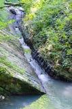 Mountain river. Flows through the gorge Stock Photography