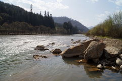 The mountain river flows among high mountains Royalty Free Stock Photo
