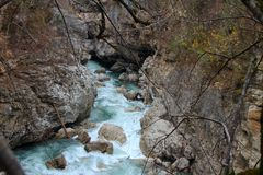 The mountain river flows among the rocks stock image