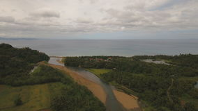 Mountain river flows into the sea..Camiguin island Philippines. stock footage