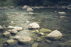 The mountain river flows swiftly and boils among the rocks royalty free stock photography