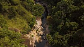 Mountain river and green forest aerial landscape. Water flow in rocky river in mountain and rainforest drone shot. Beautiful landscape wild nature top view stock video
