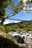 Mountain River with Hanging Bridge Stock Image
