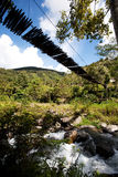 Mountain River with Hanging Bridge Stock Photography