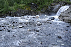 Mountain river in kiruna wilderness. Mountain river flowing in tundra Royalty Free Stock Photos