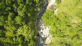 Mountain river landscape in tropical forest aerial landscape. Drone view rocky river with and green forest in mountain. Forest stock video