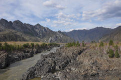 Mountain landscape river dark cliffs Stock Photography