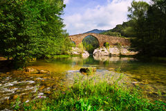 Mountain river with medieval stone bridge Royalty Free Stock Photography