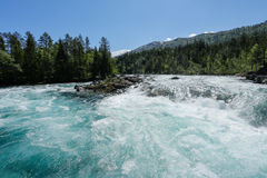 Mountain river. Melting snow river in mountains, Norway Stock Images