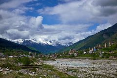 Mountain river in Mestia in spring at the beginning of the settlement royalty free stock images