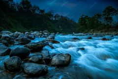 Mountain river nightscape. Nighttime landscape of a mountain river in Nepal Stock Photos