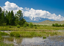 Mountain river and North-Chuya's ridge in Altai Royalty Free Stock Photo