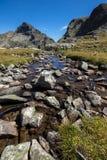 Mountain river and Orlovets peak, Rila Mountain Stock Photo