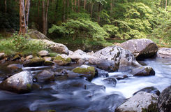 Mountain River. Peaceful mountain river rushing over moss-covered rocks - Smokey Mountains stock photography